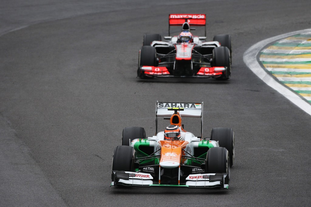 Nico Hulkenberg (GER) Sahara Force India F1 VJM05 leads the race from Jenson Button (GBR) McLaren MP4/27. Brazilian Grand Prix, Sunday 25th November 2012. Sao Paulo, Brazil.