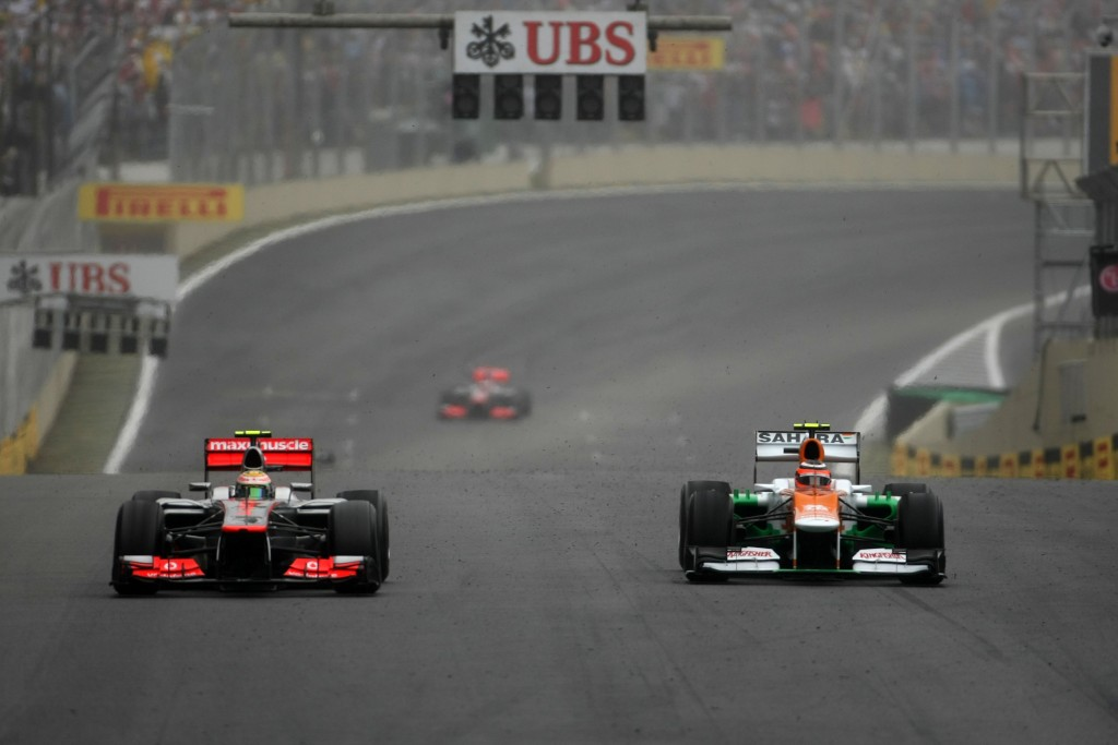Lewis Hamilton (GBR) McLaren MP4/27 battles with Nico Hulkenberg (GER) Sahara Force India F1 VJM05. Brazilian Grand Prix, Sunday 25th November 2012. Sao Paulo, Brazil.